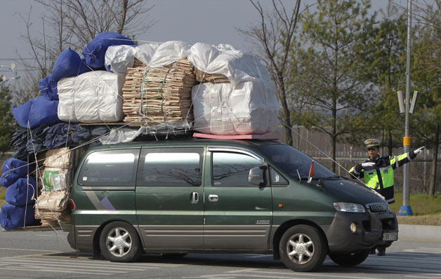 Overloaded South Korean's van fleeing North Korea