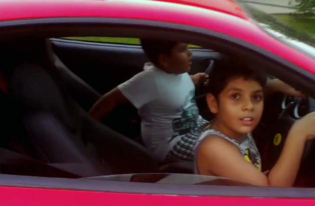 Young boy captured joyriding in father's Ferrari on video - screencap
