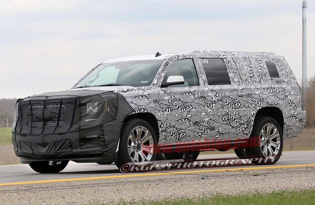 GM's next-generation SUVs caught testing in prototype form with cladding