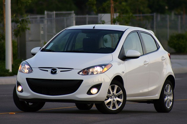 2011 Mazda2 - front three-quarter view, white