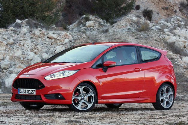 2014 Ford Fiesta ST - front three-quarter view, red