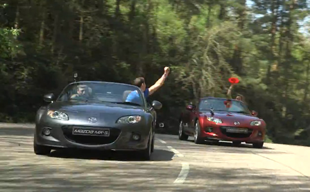 Mazda MX-5 Miata roadsters playing Frisbee - video screencap