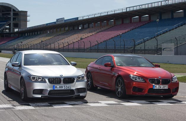 ​2014 BMW M5 and M6 Competition Package models - sitting on race track