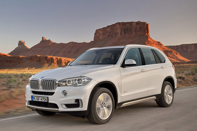 2014 BMW X5 - front three-quarter dynamic view, white