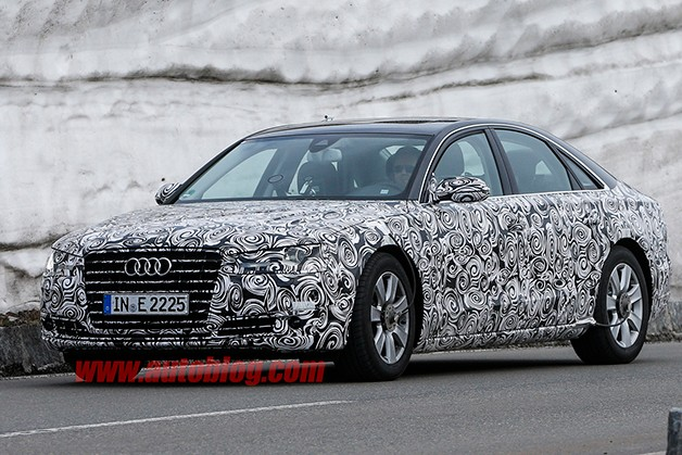 Refreshed Audi A8 caught testing under camouflage - front three-quarter view