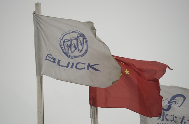 Buick and China flags fly at dealership