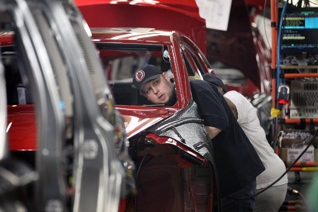Dodge Dart production line worker