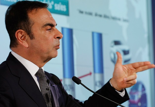 Nissan CEO Carlos Ghosn makes a gun gesture with his fingers - pew-pew!