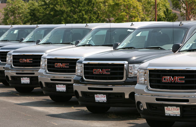 GMC pickups lined up at dealership