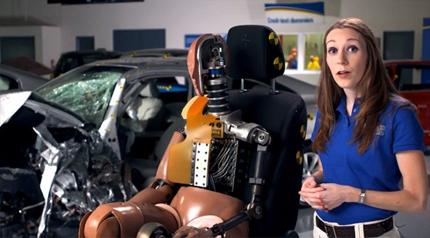 IIHS spokeswoman with dummy and crash test car - video screencap