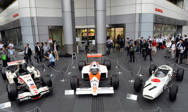 Honda and McLaren announce new F1 efforts by showing three race cars throughout history