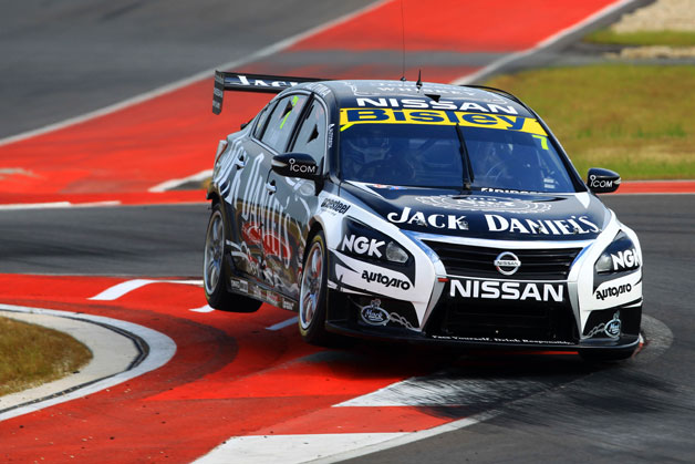 Nissan Altima V8 Supercar at COTA - lifting wheels in a corner