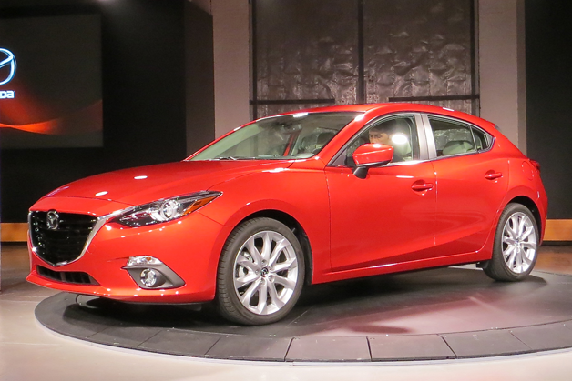 2014 Mazda3 at NYC reveal - front three-quarter view, red