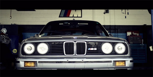 BMW E30 M3 parked in garage - front view - video screencap