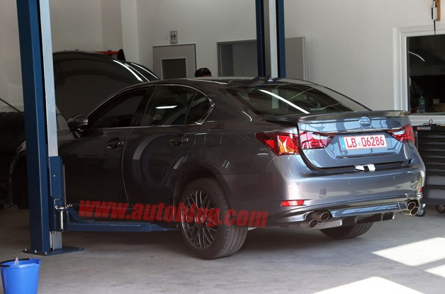 Lexus GS F spy shot - rear three-quarter in garage
