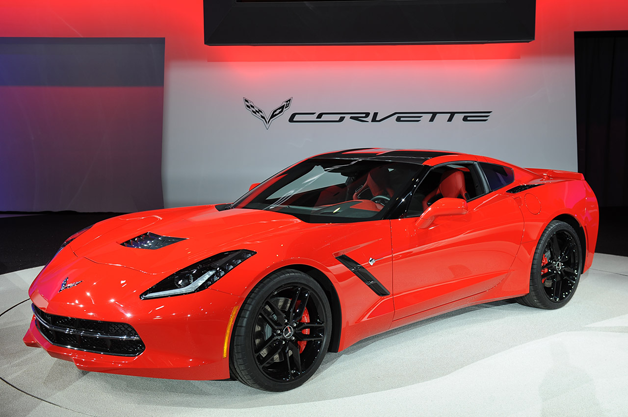 2014 Chevy Corvette C7 Coupe - front three-quarter view on show stand, red