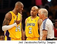 Kobe Bryant and Derek Fisher with referee