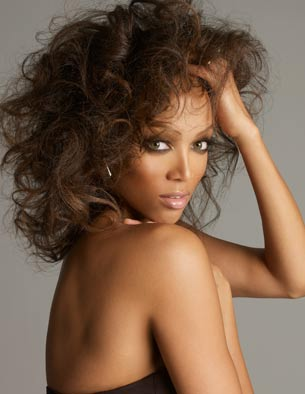 Tyra Bank with Big Hair look with soft loose curls