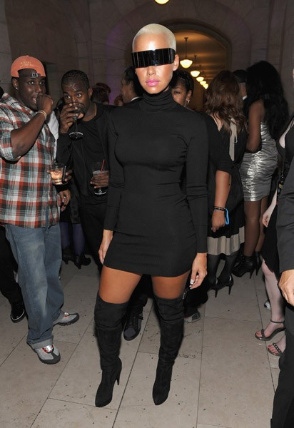 pics of amber rose with long hair. Amber Rose went for sultry and