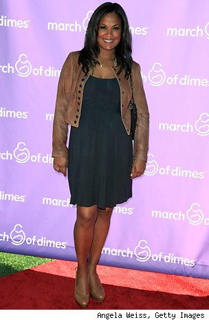 Laila Ali also kept it trendy when she paired her soft black empire-waist ...