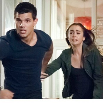 Taylor Lautner, Lily Collins Jump for Their Lives in New 'Abduction' Clip
