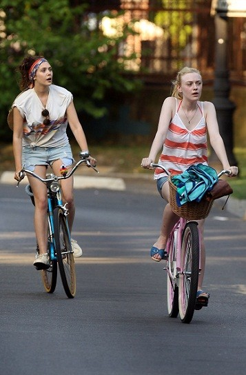 Elizabeth Olsen and Dakota Fanning on the set of 'Very Good Girls'