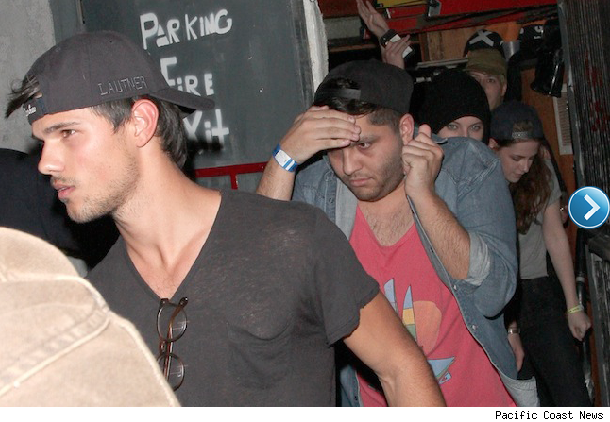 Taylor Lautner and Kristen Stewart leaving Troudadour.