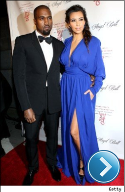 Kim Kardashian and Kanye West on a red carpet.