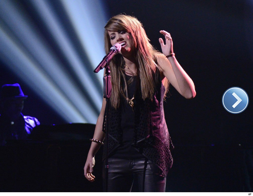 American Idol top 3 finalist Angie Miller performing on stage.