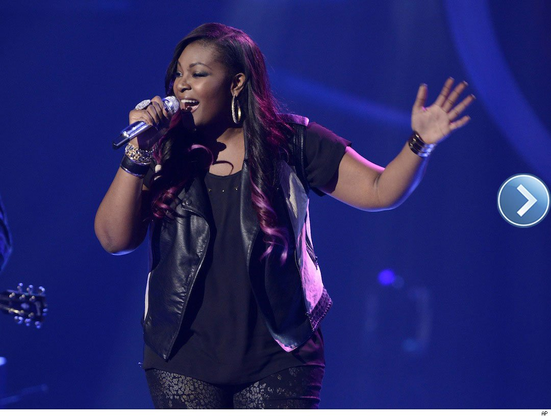 American Idol top 2 finalist Candice Glover performing on stage.