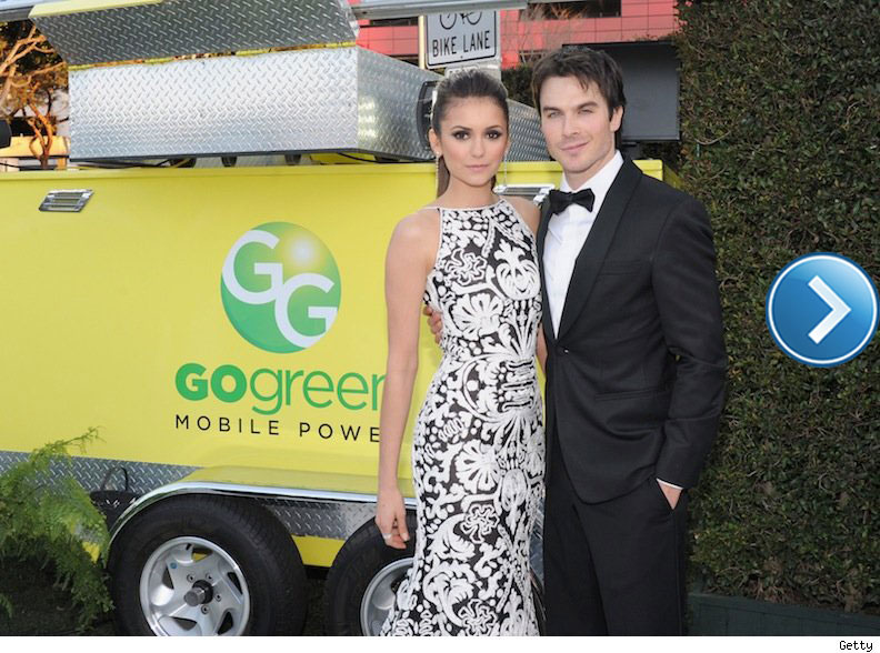 Nina Dobrev and Ian Somerhalder at a red carpet event.