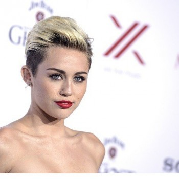 Miley Cyrus Wears Engagement Ring, Has Makeup Mishap at 'Maxim' Party