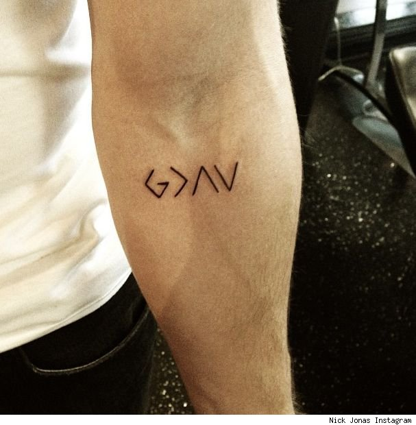 Nick Jonas new god tattoo meaning