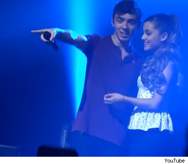 Nathan Sykes serenades Ariana Grande on stage The Wanted concert Max George carried her