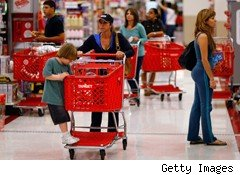 Target plans to expand from the suburbs into the cities, starting with Seattle in 2012.