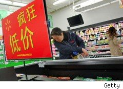 A Chinese consumer contemplates a purchase at a grocery.