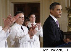 President Obama discussing health care, with doctors applauding