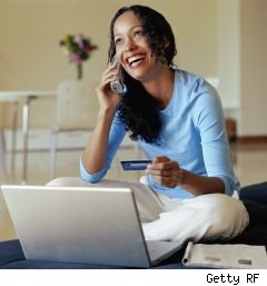young woman ordering something online holding a credit card