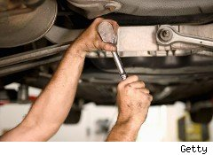 Car mechanic works on auto