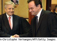 European Central Bank President Jean-Claude Trichet (L) shakes hand with Greek Finance Minister Giorgos Papakonstantinou before an emergency meeting of EU ministers to arrange a bailout for Greece.
