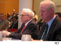 Warren Buffett and Raymond McDaniel