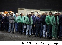 Workers line up to hear President Barack Obama deliver a speech on jobs and the economy