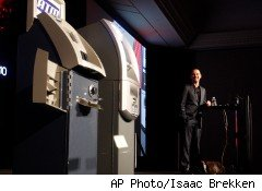 At the Black Hat computer-security conference, Hacker Barnaby Jack demonstrates his ability to hack into two ATMs and get money from them.