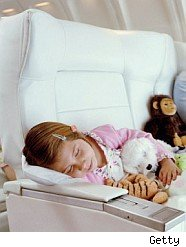 Child asleep in airplane
