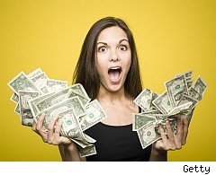 Woman with fistfuls of cash