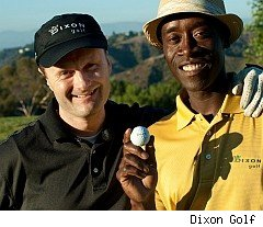 Actor Don Cheadle with green golf ball