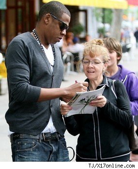 Rapper Jay-Z signs autographs for fans.