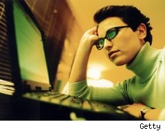 computer privacy, girl in green glasses looking at computer