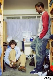 two young men in a small dorm room