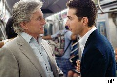 Shia LaBeouf, right, on the Wall Street: Money Never Sleeps set with Michael Douglas